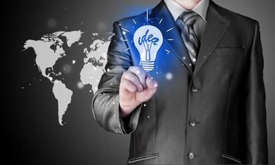 Business man touching light of idea