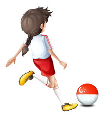 A female athlete kicking the ball with the flag of Singapore