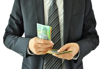 Businessman holding money  - Australian dollars