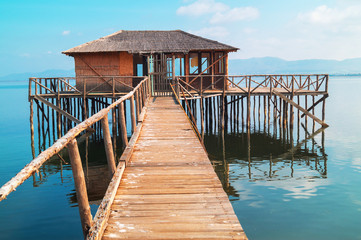 Wooden cottage lake settlement, Greece