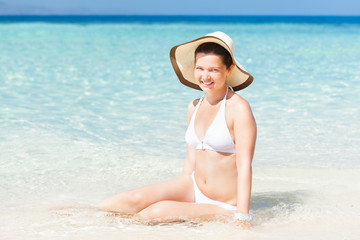 Sexy Woman Sitting On Sunny Beach