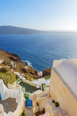 Fototapete - View to the sea and Volcano from Fira the capital of Santorini i