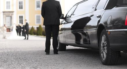 Black limo at wedding