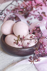 Pink easter eggs with blossom brunch