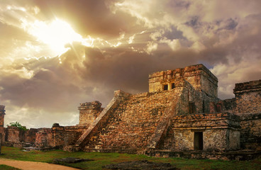 Foto auf Leinwand Mexiko Castillo fortress at sunrise in the ancient Mayan city of Tulum,