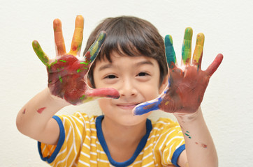 Little two hand boy colorful play water color