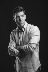 portrait of sexy man model doing a fashion shoot in the studio -