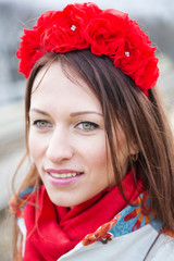 Zoomed woman with head decoration from flowers