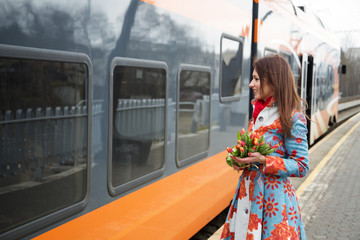 Woman with flowers adopt finaly come train