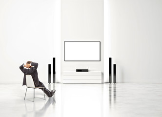 businessman watching home cinema
