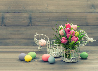 pink tulip flowers and easter eggs. vintage style