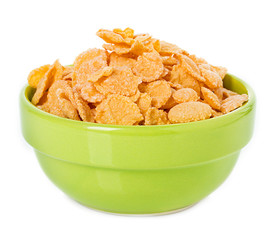 Bowl with corn flakes on the white background