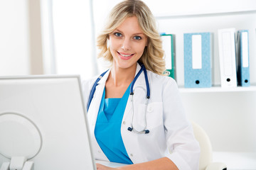 Female doctor with computer