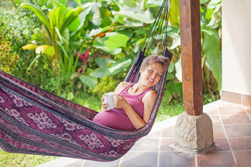 Pregnant woman in hammock