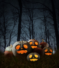 Halloween orange pumpkins at night.