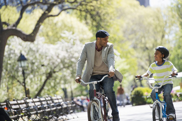 Bicycling And Having Fun. A Father And Son Side By Side.