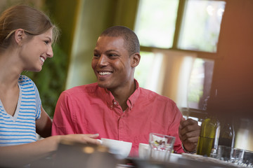 Two People, A Man And Woman Seated Close Together, Looking At Each Other. Having A Cup Of Coffee.