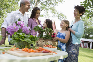 Family Party. A Table Laid With Salads And Fresh Fruits And Vegetables. Parents And Children.