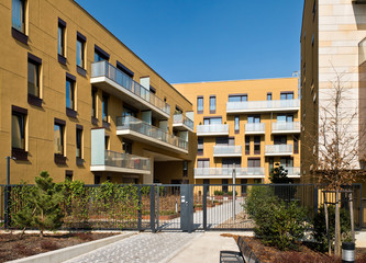 Newly built block of flats with security fence