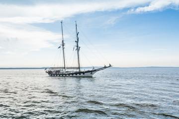 Tall ship on blue water horizontal