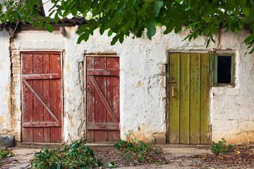 Three old wooden plank vintage doors