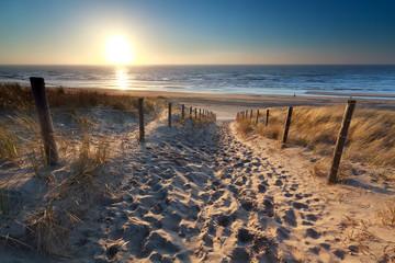 Autocollant pour porte Eau sunshine over path to beach in North sea