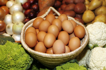 Eggs/Basket with fresh brown eggs on market