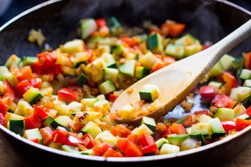 Cooking stew ratatouille from vegetables in frying pan, tasty