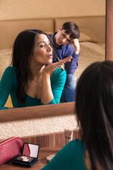Beautiful woman putting make up