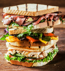 Stacked grilled sandwiches with fresh ingredients