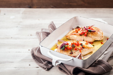 Serving of golden roasted chicken breasts