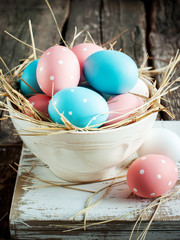 Easter eggs in a white shabby bowl