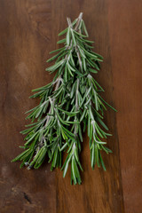 fresh rosemary on a wooden table