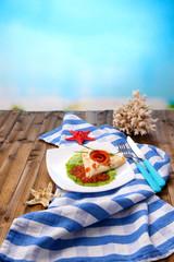 Pancake with red caviar, salmon and mayo, green onion,