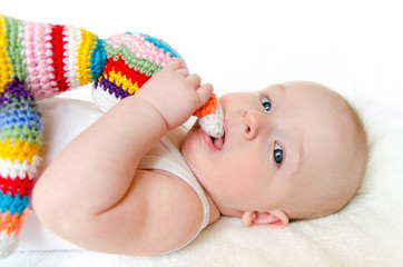 adorable baby playing with  hand made crochet toy