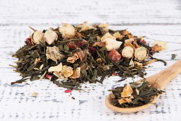 Aromatic dry tea on wooden background