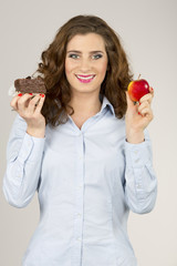 Female model portrait with an apple and pastry.