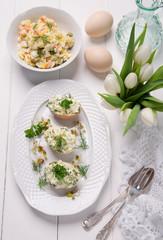 Obraz easter dishes,stuffed eggs and potato salad - fototapety do salonu