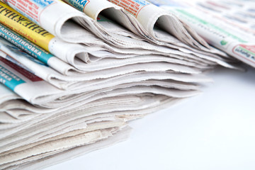 stack of newspapers close-up