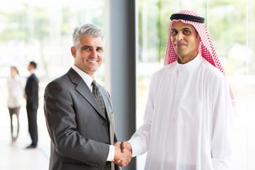 senior businessman handshake with Arabian partner