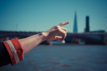 Pointing at skyline