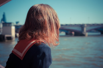 Woman relaxing on boat on the Thames