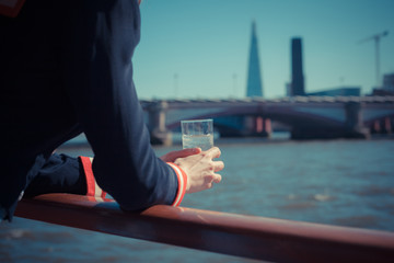 Relaxing with drink of water on a boat