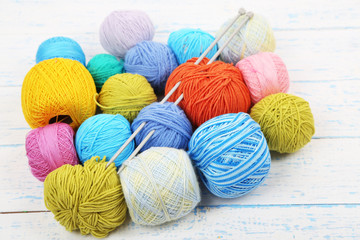 Yarns for knitting on wooden table close-up