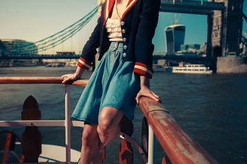 Woman touring the Thames on a boat