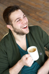 Man smiling with cup of coffee