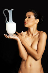 Nude woman with milk.