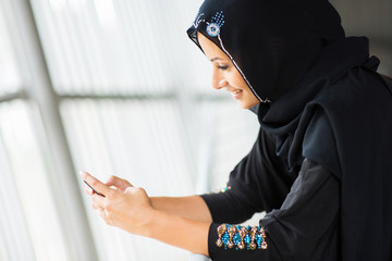 middle eastern woman using smart phone