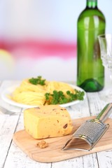 Composition with tasty spaghetti, grater, cheese, wine bottle