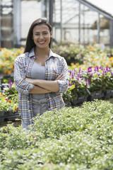 A woman in an organic nursery greenhouse.